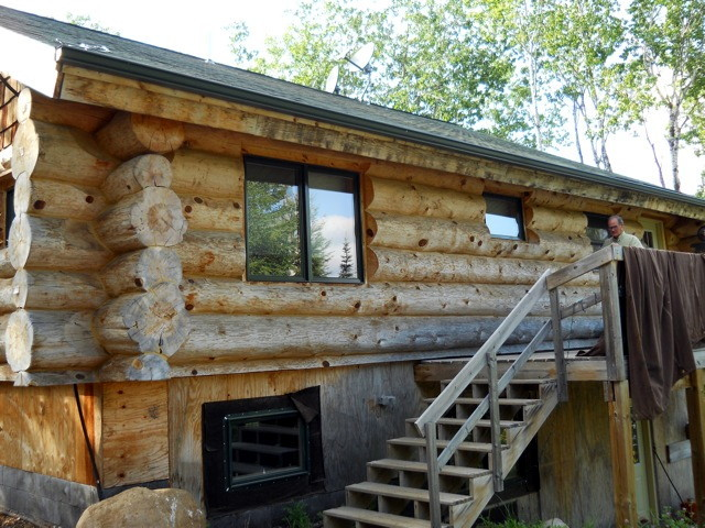 Most of the grey color in the wood was removed by cleaning the logs using OxiClean a non-chlorine cleaner. Note: Chlorine-based cleaners can cause problems with the stain that is applied afterwards. Avoid chlorine use on your logs!