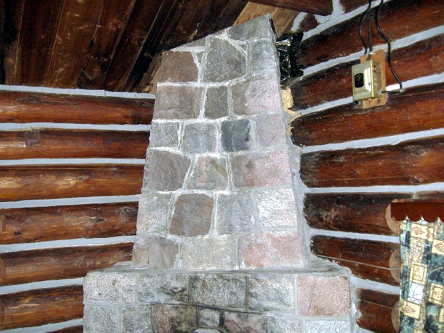 In this log home, the chinking is a contrasting color to the logs and is fairly wide. This is a common look in older log homes.