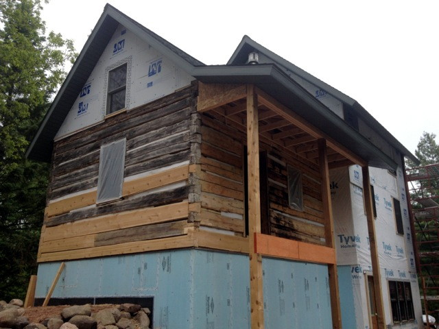 Historic log home restoration in poplar wi edmunds and for Log cabin restoration
