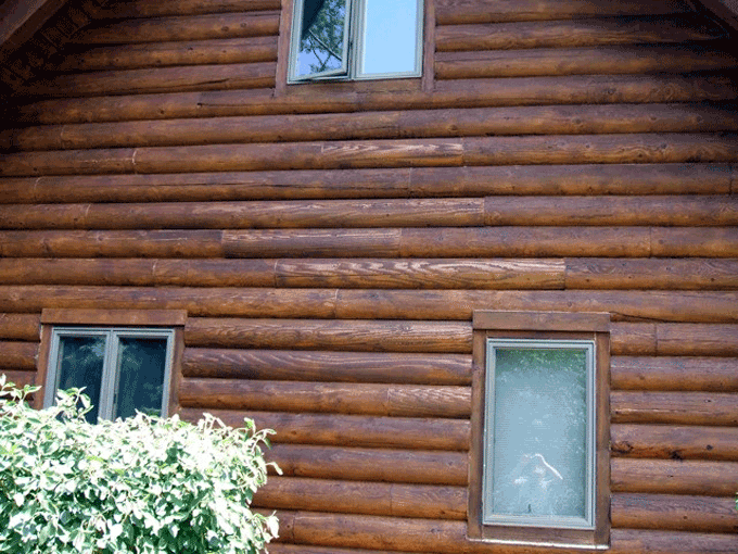 After the cedar half-logs were installed it's hard to tell which ones they were once the house was stained.