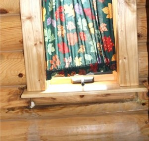 Log Cabin Repair – Leaking around windows – what's the solution?