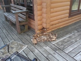 Log home repair: Protect your log home from the elements by putting up gutters.