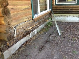 Log home restoration – rotten logs replaced