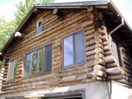 Sand blasting log homes – you want a professional for this job! Trust us.
