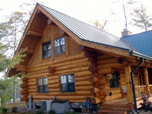 A freshly blasted and stained log home.