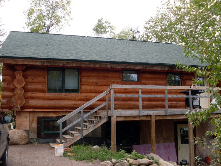 A log home that has been cleaned and re-stained.