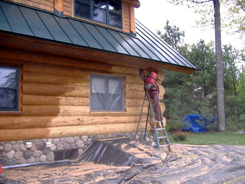 Finish being sandblasted off of a wood home.