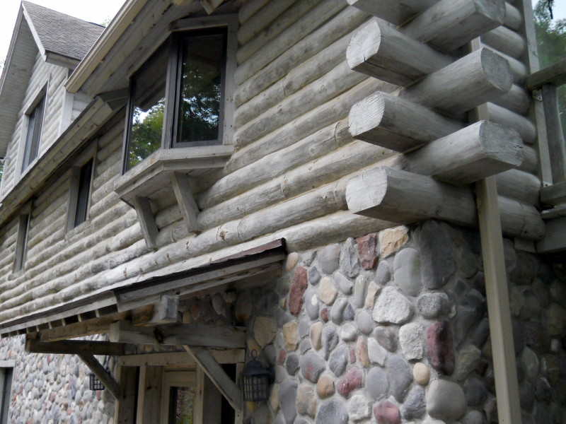view of a log home showing flat log surfaces that necessitate chinking.