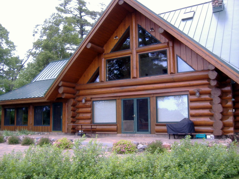 Log home refinishing back brushing stain for How to stain log cabin