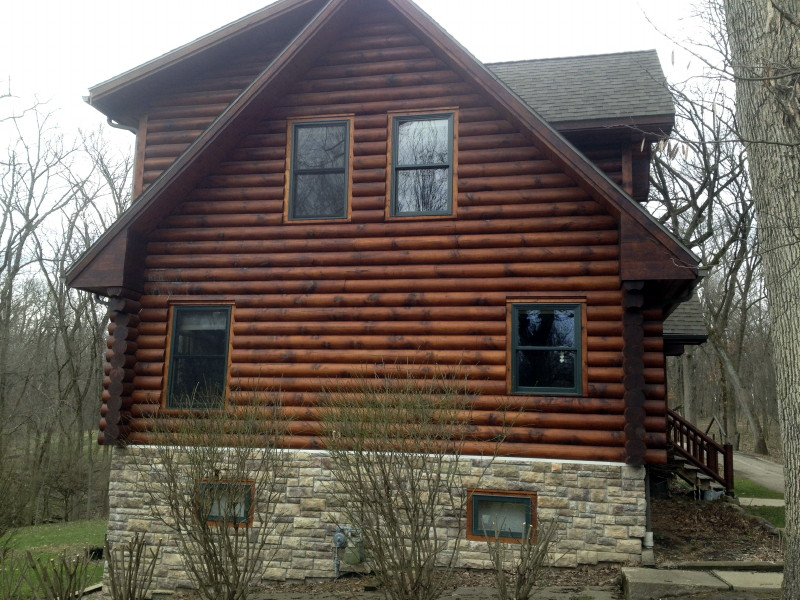Log home staining problems edmunds and company for How to stain log cabin
