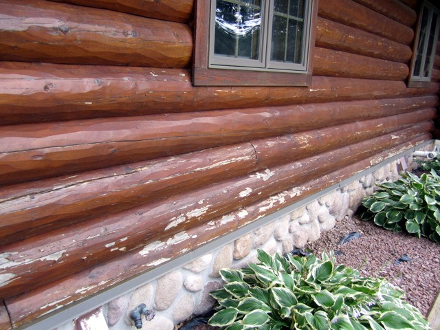 A log home with pealing finish that needs to be blasted and re-stained.