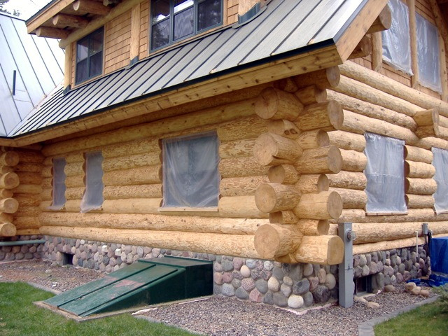 A freshly sand blasted log home.
