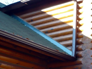 Roof of a log home that has been repaired and flashed properly.