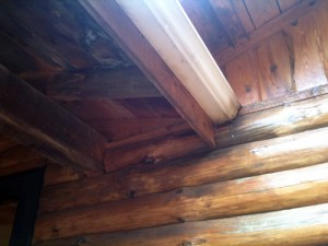 Prevent Rot: Flash Decks Attached to Log Walls