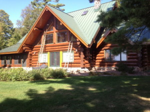 log home after blasting and re-staining
