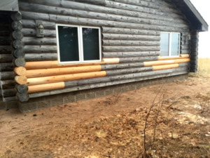 replaced rotten log siding