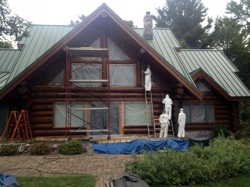 Crew prepping for staining log home