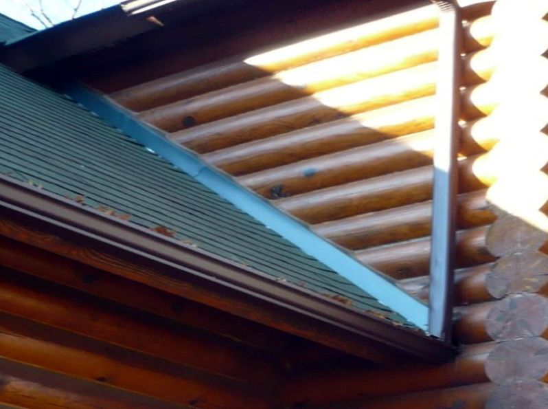 Restored log walls and roof flashing