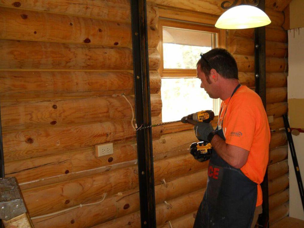 Installing log wall braces