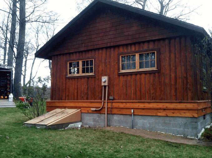 Restored vertical log home