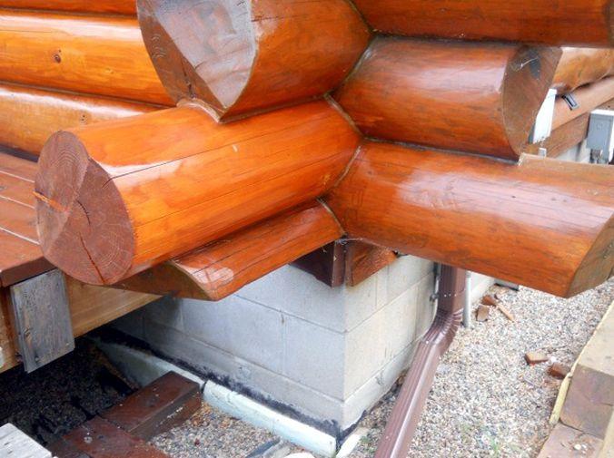 Careful caulking on new log ends