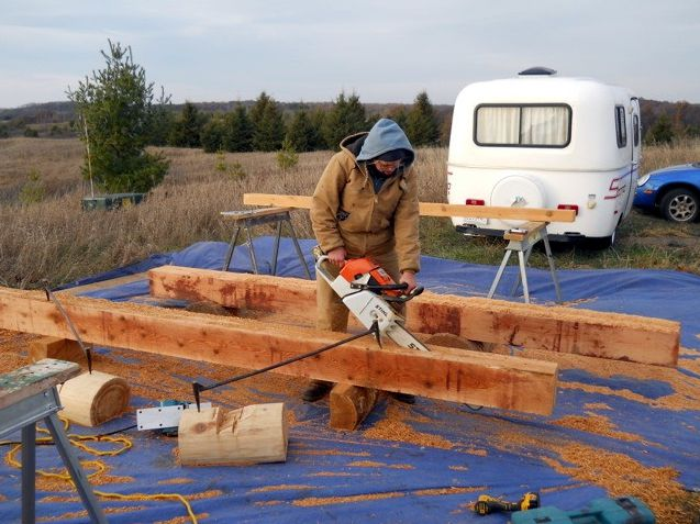 Shaping cedar hewn logs