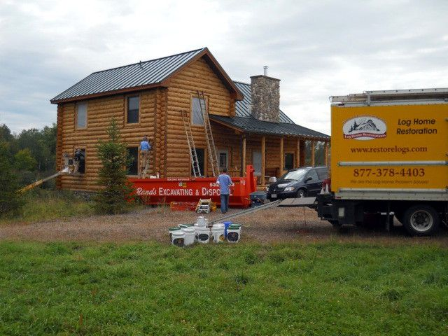Crew refinishing log home